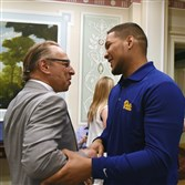 Pitt's James Conner with Dr. Stanley Marks of UPMC today at the Duquesne Club Downtown.