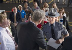 Pennsylvania state Trooper Adam Janosko's name is called during a ceremony held to recognize firefighters and police officers that have revived drug overdose victims with Narcan (naloxone) held at the Main Street Pavilion in Washington, Pa., on Tuesday.