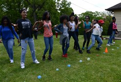Eighth-grade girls from Wilkinsburg and Westinghouse line up to take on the eighth-grade boys in a water balloon fight during  a field day Tuesday at North Park Lodge in McCandless.