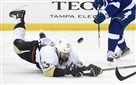 Nick Bonino dives for a loose puck against the Tampa Bay Lightning.