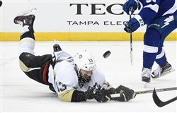 The Penguins' Nick Bonino dives for a loose puck against the Lightning at Amalie Arena in Tampa, Fla. Tuesday night.