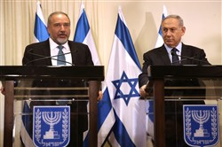 Israeli Prime Minister Benjamin Netanyahu, right, and Avigdor Lieberman, left, the head of hard-line nationalist party Yisrael Beitenu, are seen during a ceremony in which they signed a coalition agreement Wednesday at the Knesset in Jerusalem.