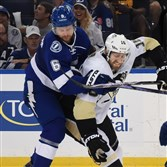 Eric Fehr battles Tampa Bay's Anton Stralman for the puck.
