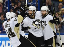 Penguins' Bryan Rust celebrates after scoring against the Tampa Bay Lightning during Game 6 at Amalie Arena in Tampa, Fla.