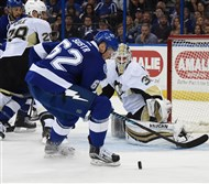 Penguins goalie Matt Murray makes save on the Lightning's Andrej Sustr in the second period at the Amalie Arena in Tampa, Fla.
