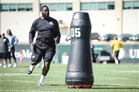 Steelers defensive lineman DeVaunte Sigler pursues a Mobile Virtual Players dummy during a pursuit drill May 19 at the Steelers' South Side facility.