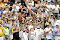 Francisco Cervelli, left, celebrates with Gerrit Cole after Cole hit a three-run home run Thursday against the Arizona Diamondbacks.