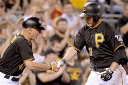 The Pirates' David Freese is congratulated by third-base coach Rick Sofield after hitting a two-run home run against the Diamondbacks in the fifth inning Wednesday at PNC Park.