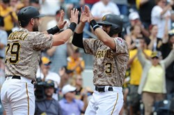 Pirates catcher Francisco Cervelli, left, and infielder Sean Rodriguez celebrate after a two-run double by Josh Harrison.