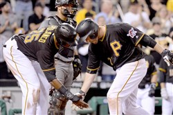 Pirates' David Freese is congratulated by Gregory Polanco after hitting a two-run home run against the Diamondbacks in the fifth inning Wednesday at PNC Park.