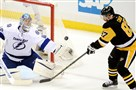 Captain Sidney Crosby tries to get a shot by Lightning goaltender Andrei Vasilevskiy in the second period.