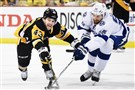 Conor Sheary battles for a loose puck with the Lightning's Braydon Coburn in Game 7 Thursday night at Consol Energy Center.