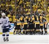 The Penguins celebrate after beating the Tampa Bay Lightning in Game 7 at the Consol Energy Center Thursday night.