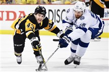Pittsburgh Penguins Conor Sheary battles for loose puck with the Lightning Braydon Coburn on Thursday at Consol Energy Center.
