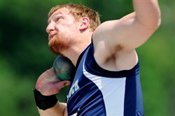 Knoch's Jordan Geist breaks the meet record with a throw of 74 feet, 3½ inches to win the Class AA boys shot put at the  PIAA track & field championships Friday at Seth Grove Stadium at Shippensburg University.