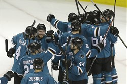 Sharks players celebrate after beating the St. Louis Blues in Game 6 of the NHL's Western Conference final.