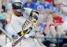 Outfielder Andrew McCutchen connects for a single to right during the fifth inning against the Texas Rangers Friday night in Arlington, Texas.