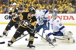 The Lightning's Andrei Vasilevskiy makes a save on the Penguins' Sidney Crosby.