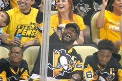 Steelers head coach Mike Tomlin with his sons in May at a Penguins game.