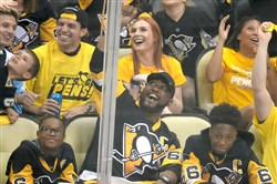 Steelers head coach Mike Tomlin takes in the action as the Penguins take on the Lightning in the first period of Game 7 of the Eastern Conference final May 26, 2016.