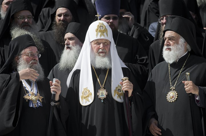 Greece Russia-6 Patriarch Kirill of Moscow, center, poses for cameras with orthodox monks in Karyes, the capital of Mount Athos, Greece, last month ahead of Russia's president Putin visit.