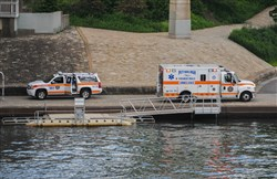 Police and paramedics arrived at Point State Park after a body was found in a wooded area along the river.