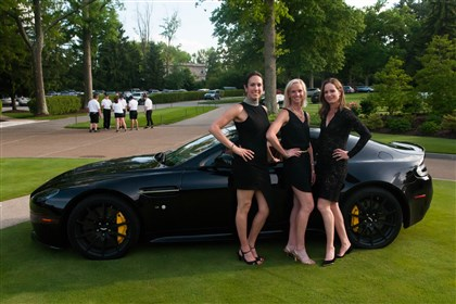 River Rocks event co-chairs Marcia Haberman, Tiffany Buchanan and Erin Christoforetti pose at the Fox Chapel Golf Club next to the Aston Martin Vantage S.