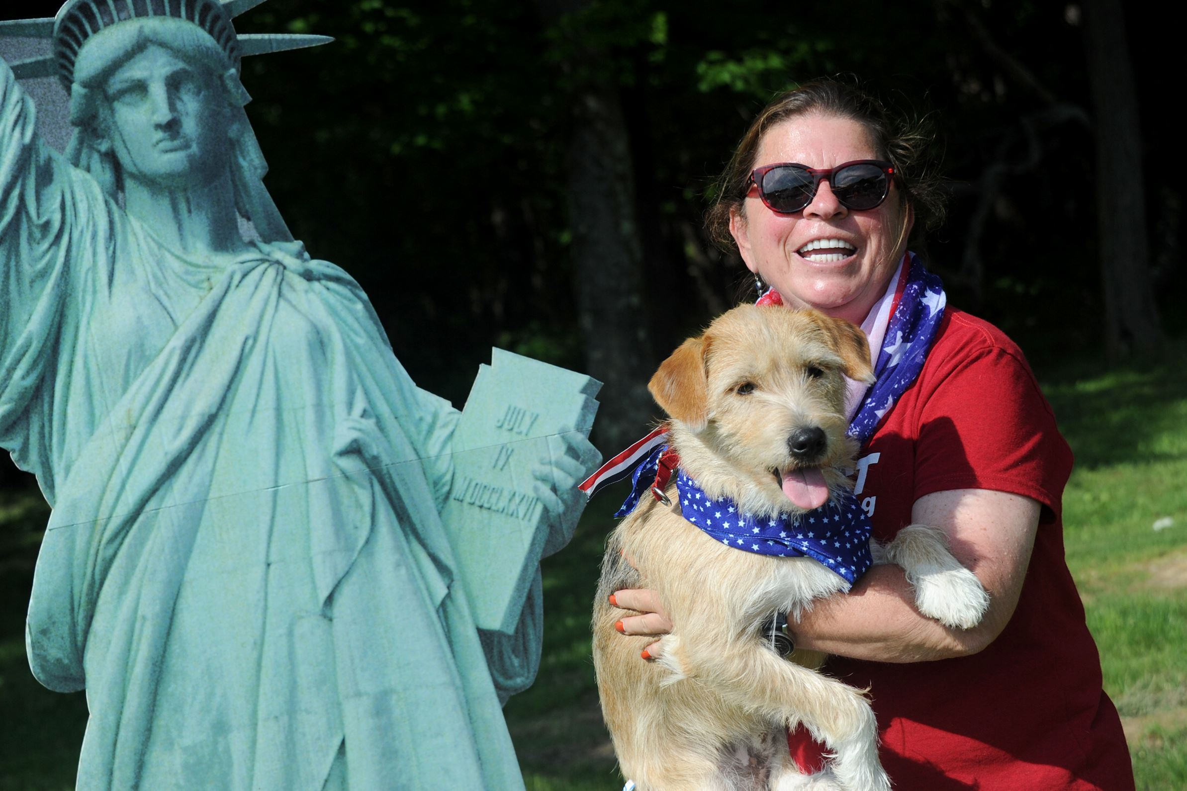 20160528lf-Dogs01 Gretchen Meyer of Gibsonia holds her adopted pup, Jameson, a 15-month-old Terrier mix at the annual Animal Friends Patriotic Pup Parade in North Park on Saturday.