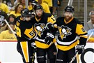 Penguins defensemen Kris Letang (right) and right winger Phil Kessel (right) help center Nick Bonino off the ice after he was injured in Game 7 of the Eastern Conference final at Consol Energy Center Thursday.