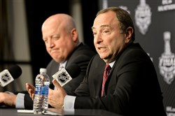 NHL commissioner Gary Bettman talks about the state of the NHL next to deputy commissioner and chief legal officer Bill Daly at Consol Energy Center Monday before the start of the Stanley Cup final between the Penguins and the Sharks.