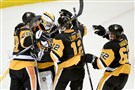 Ian Cole, Ben Lovejoy and Carl Hagelin congratulate goaltender Matt Murray after defeating the Sharks in Game 1 of the Stanley Cup final Monday at Consol Energy Center.