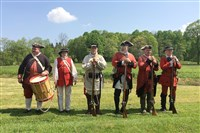 Re-enactors pose before demonstrating their muskets for visitors at Fort Necessity National Battlefield near Farmington in Fayette County. Credit: Bob Batz Jr. For the National Parks series.