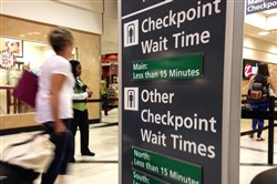 Airline passengers enter the main security checkpoint at Hartsfield-Jackson International Airport in Atlanta on Monday.