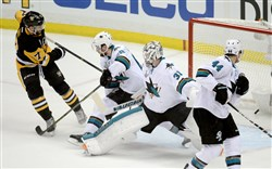 The Penguins' Bryan Rust scores on Sharks goaltender Martin Jones in the first period of Game 1 of the Stanley Cup final Monday at Consol Energy Center.