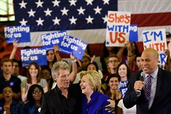 New Jersey musician Jon Bon Jovi, left, with Democratic presidential candidate, Hillary Clinton, after being introduced by U.S. Senator Cory Booker, NJ-D, during a campaign event  at Rutgers University Newark Campus in June.