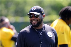 Steelers coach Mike Tomlin flashes a smile June 1 before workouts on the South Side.