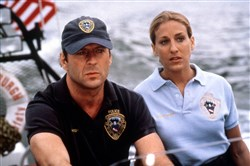 "Bruce Willis and Sarah Jessica Parker in the 1993 movie ""Striking Distance."""