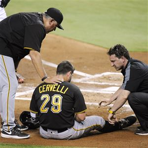 Francisco Cervelli talks with Clint Hurdle, left, and Todd Tomczyk after being hit by a pitch against the Marlins in June 2016.