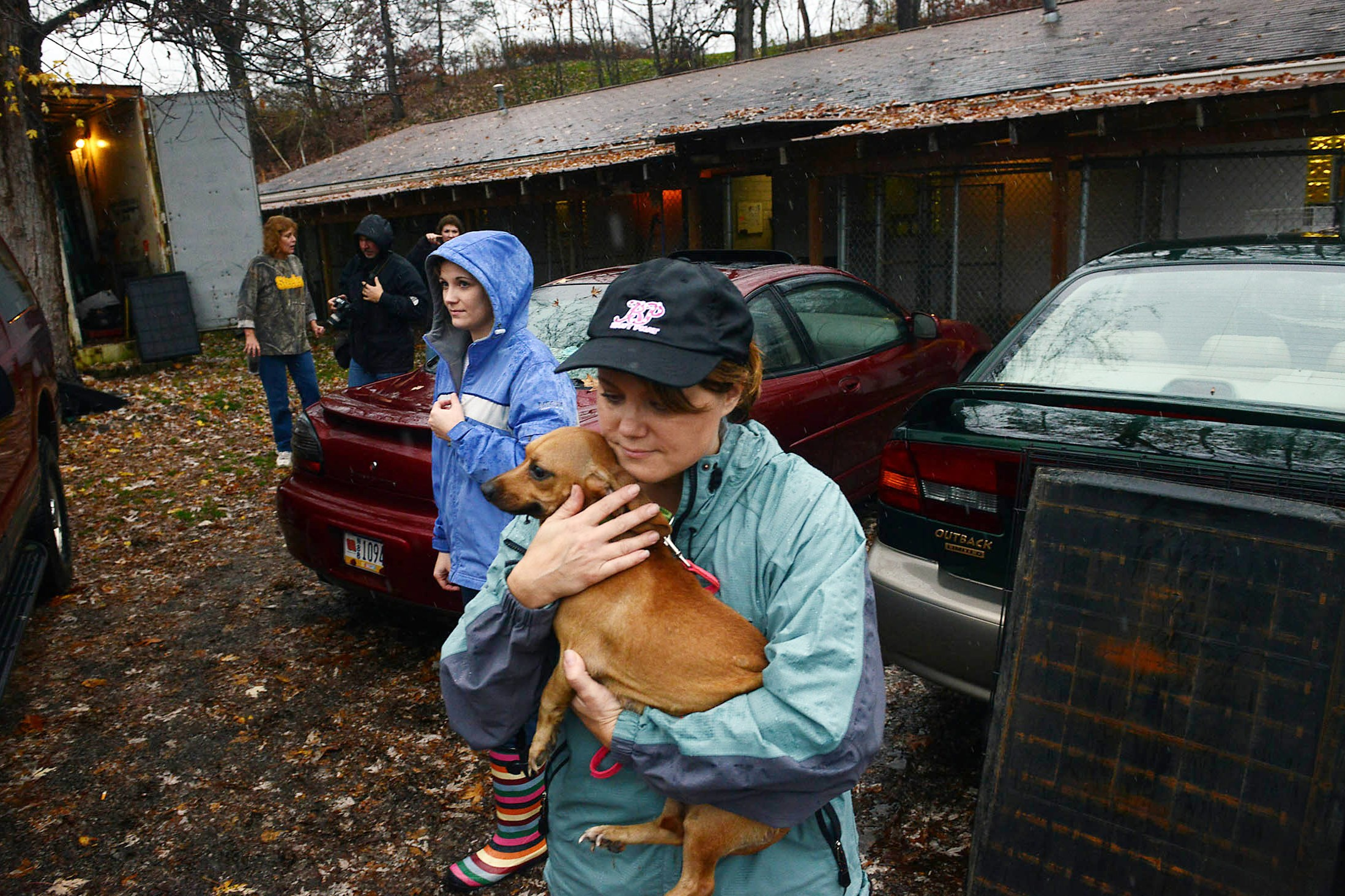 Debbi Reefer carries a dachshund as volunteers and staff of Orphans of the Storm, an animal shelter in Kittanning, work to evacuate animals in anticipation of possible flooding from Hurricane Sandy in 2012.