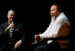 Chinese activist artist Ai Weiwei, right, speaks with Eric Shiner, director of The Andy Warhol Museum, during a forum held in the Carnegie Music Hall.