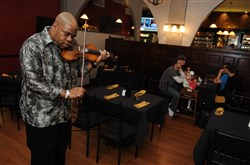 James Street Gastropub & Speakeasy serves eclectic pub fare and also offers live performances. Graham Denmon plays violin during Happy Hour.