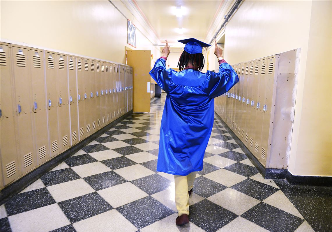 96d31fa8ace Anfernee Fleming visits his locker one last time Friday before the final  commencement at Wilkinsburg High