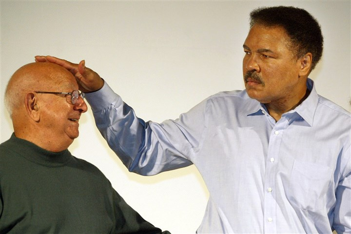 91t00kuj-29 In this Oct. 9, 2003 file photo, boxing legend Muhammad Ali touches the head of his former coach Angelo Dundee at the Book Fair in Frankfurt, Germany.