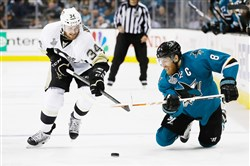 Joe Pavelski, right, of the San Jose Sharks fights for the puck with the Penguins' Tom Kuhnhackl in Game 3 of the Stanley Cup final Saturday at SAP Center in San Jose, Calif.