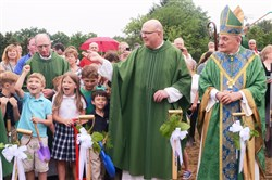 The Rev. Paul J. Zywanm, left, and Bishop David A. Zubik, stand along-side children for the ground-breaking ceremony for the new St. Alexis Church June 4 in McCandless.