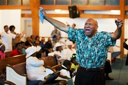 Rahaman Ali, brother of Muhammad Ali, shows emotion during a service Sunday at King Solomon Missionary Baptist Church in Louisville, Ky., where the Alis' father worshipped and where Muhammad Ali would occasionally accompany him. The funeral for the former heavyweight boxing champion, who died Friday at the age of 74, will be held next Friday in Louisville.