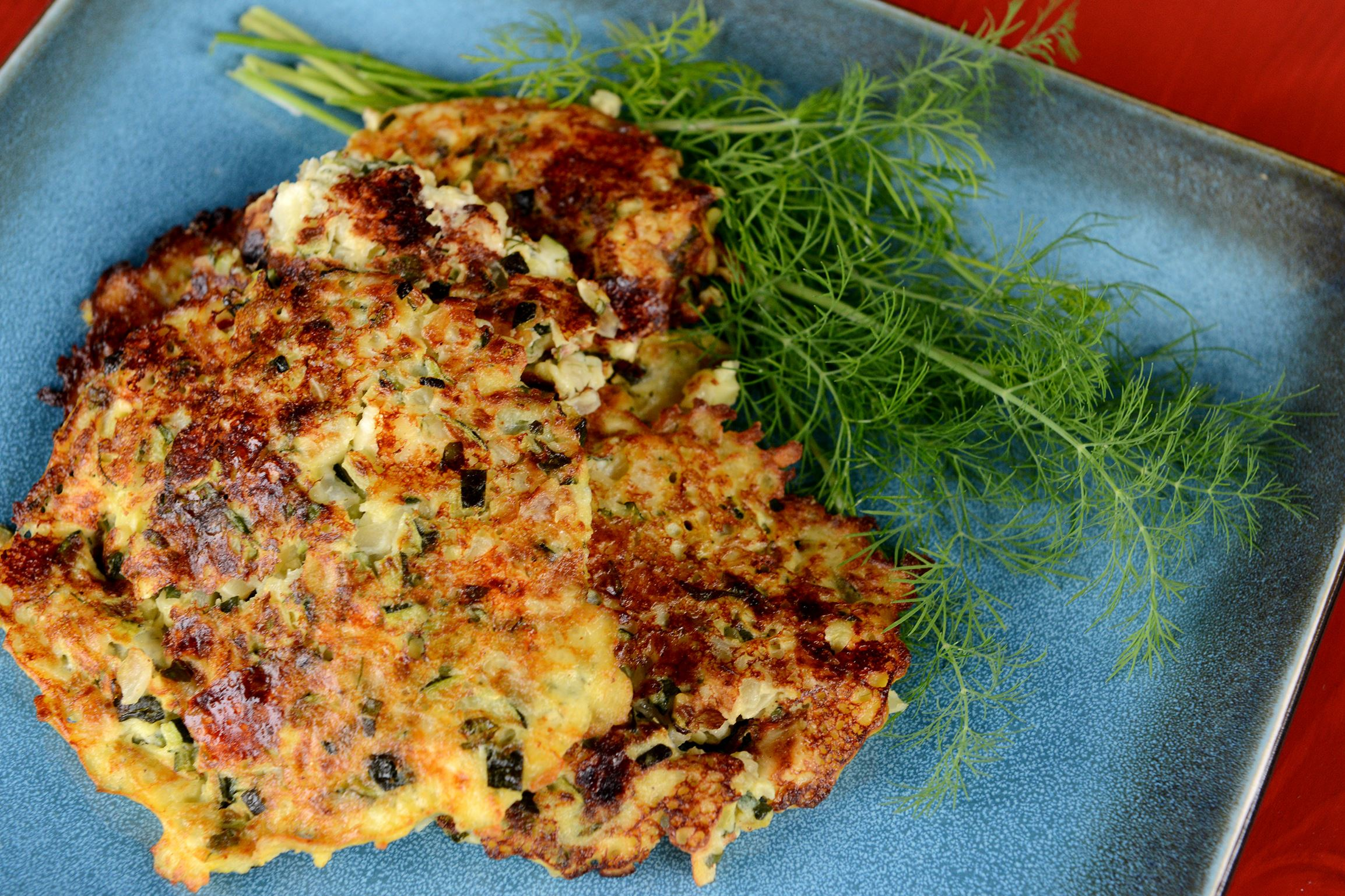 ... -10 Zucchini fritters, made with onions, feta cheese, dill and mint