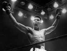 Muhammad Ali celebrates after knocking out Charlie Powell at Civic Arena in Pittsburgh on Jan. 24, 1963.
