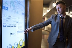 Adam Brandolph, a spokesman for the Port Authority, demonstrates how to use a prototype of the digital information kiosk to get directions.
