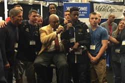 Boxing legend George Foreman poses with Nehemiah Hollinger, right, and other Team Pittsburgh boxers and coaches Wednesday at Monroeville Convention Center.